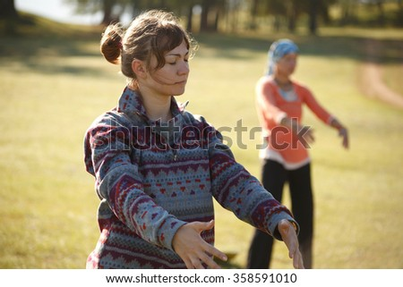Two women are practicing Qi Gong - stock photo