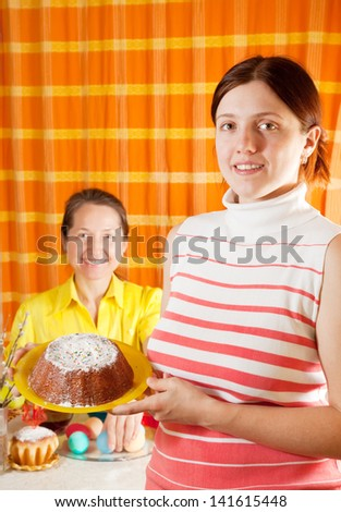 Two women are preparing for  Easter holiday in home - stock photo