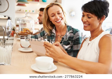 Two women at a meeting in a cafe - stock photo