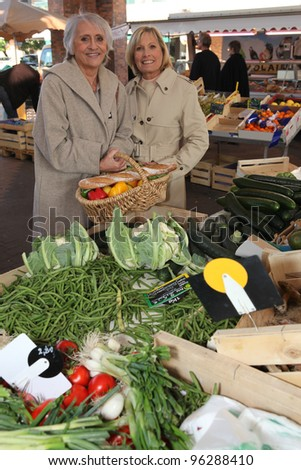 Two women at local market - stock photo