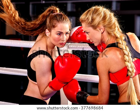 Two  women boxer wearing red  gloves to box in ring. Martial arts. - stock photo