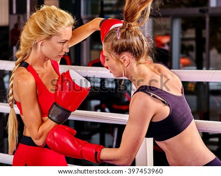 Two women boxer wearing red  gloves to box in ring. Martial arts concept. - stock photo