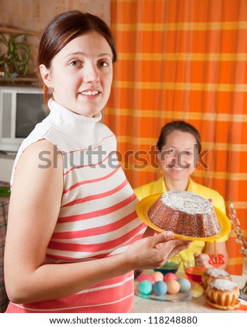 Two women celebrating Easter in their home - stock photo