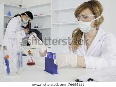 Two women conducting an experiment in a lab