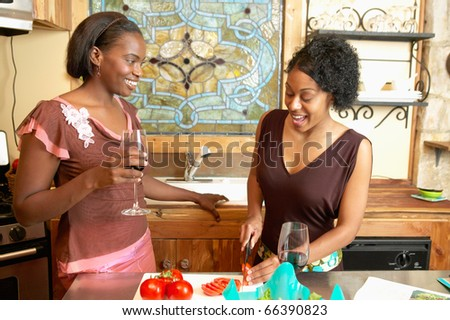 Two women cooking - stock photo