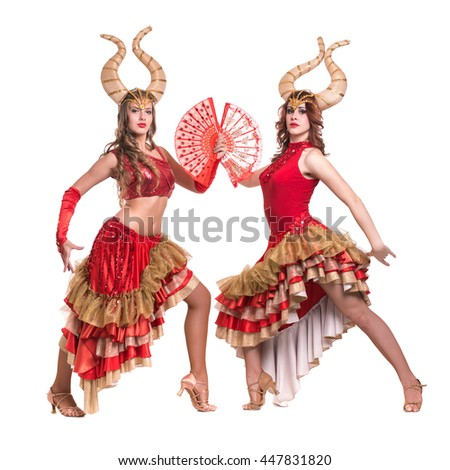 Two women dancers with horns. Isolated on white background. - stock photo