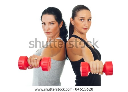 Two women doing exercises with barbell isolated on white background - stock photo