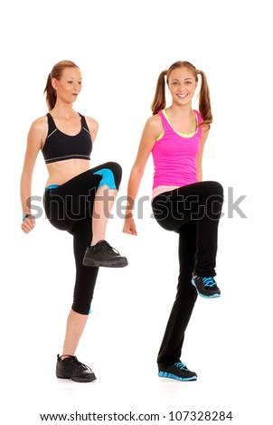 Two women doing fitness - stock photo