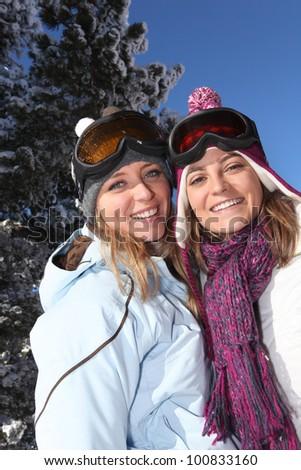 Two women enjoying their skiing holiday - stock photo