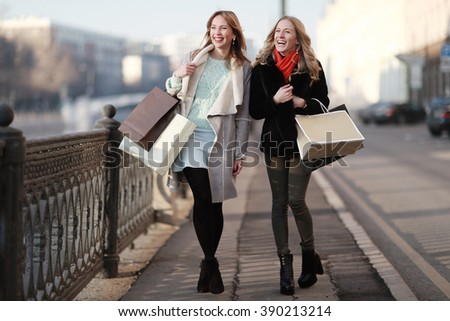two women friends traveling city happiness - stock photo