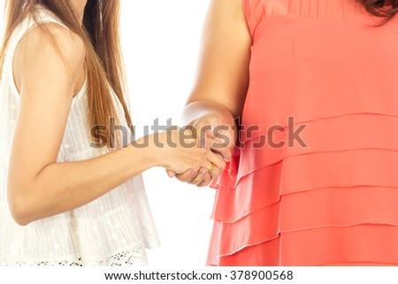 Two women give handshake after agreement, isolated on white background