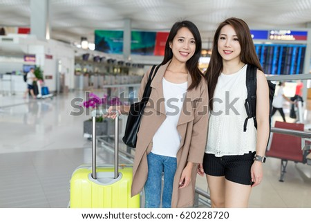 Two women go travel together in Hong Kong international airport