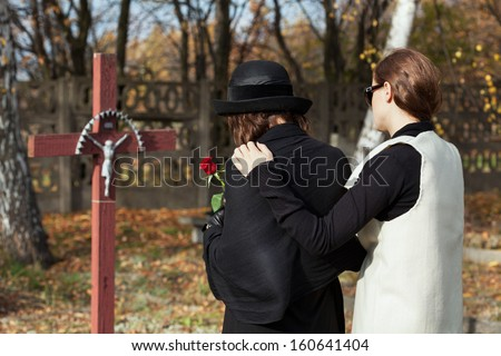 Two women grieving following loss of family memeber - stock photo