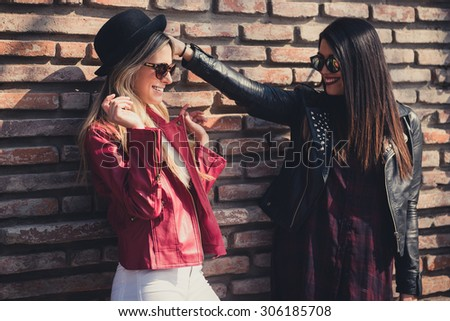 Two women hanging out in the city. - stock photo