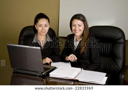 Two women having a meeting at a conference table