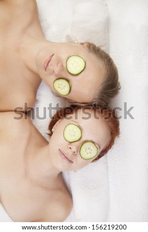 two women having procedures in spa salon