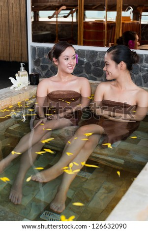 Two women having spa procedures - stock photo