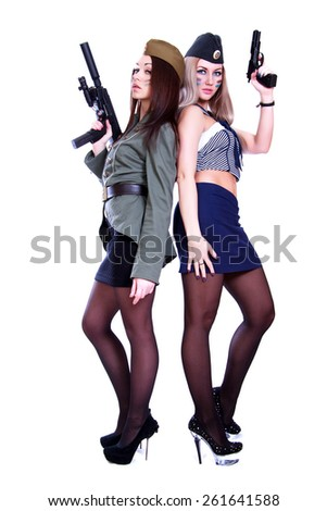 Two women in a vintage military uniforms with guns isolated over white background - stock photo