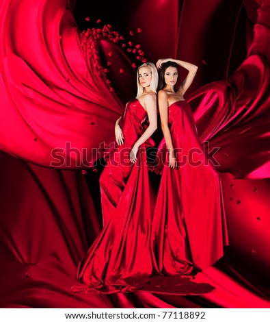 two women in blue dress with long hair and hearts  on red drapery