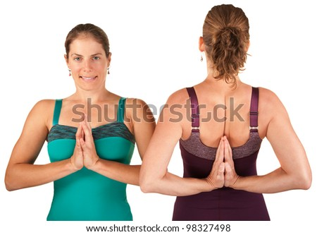 Two women in forward and backward namaskar salutation poses over white background - stock photo