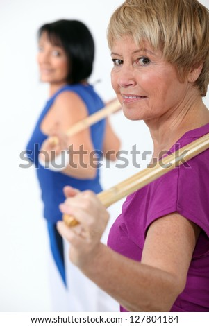 Two women in gym class - stock photo