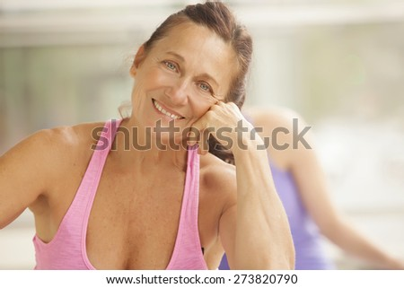 Two women in gym class, relaxation exercise - stock photo