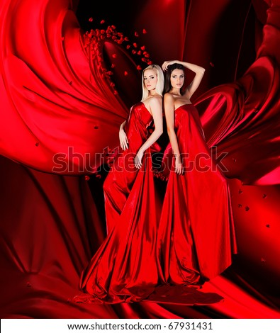 two women in red dress with long hair and hearts  on red drapery