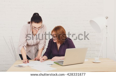 Two women in the office. Teamwork, colleagues, business communication.