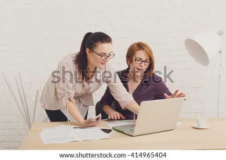 Two women in the office. Teamwork, colleagues, business communication. Success, happiness. Working process. Middle-aged architects designers in team work discuss project. Start up discussion.  - stock photo