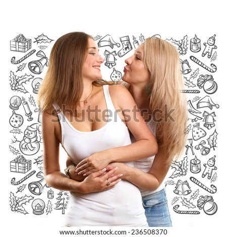 Two Women looking for Christmas gifts and choosing it - stock photo