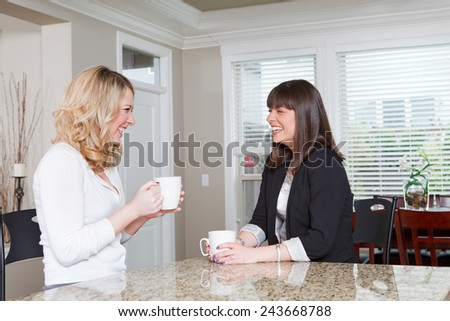 Two women meeting in a house for a coffee.