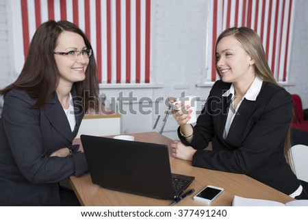 two women of the colleague talk at office - stock photo