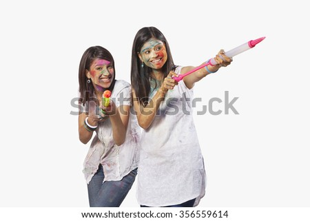 Two women playing holi - stock photo