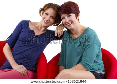 two women posing on white background as Best Friends Forever - stock photo