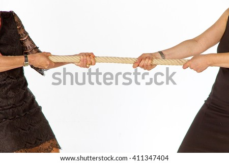 Two women pulling a rope - stock photo