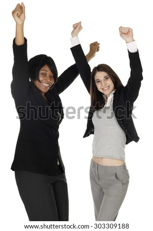 Two women raising arms in joy.