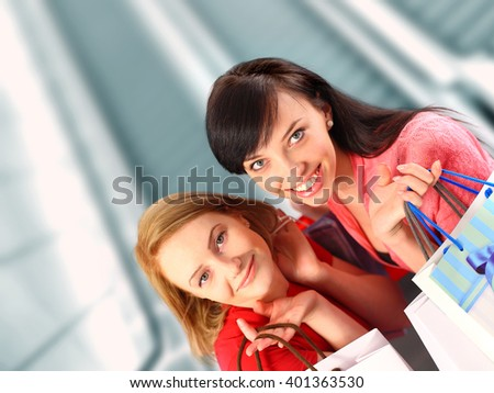 Two women shopping at the mall - stock photo