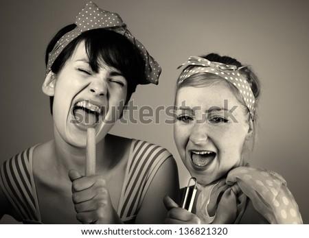 Two women singing together. Karaoke, retro style. - stock photo