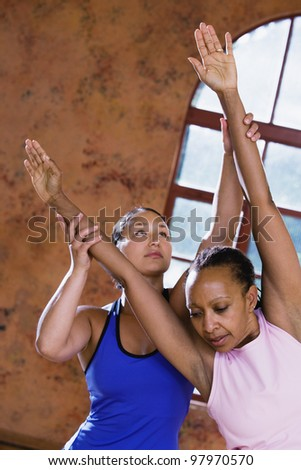 Two women stretching - stock photo