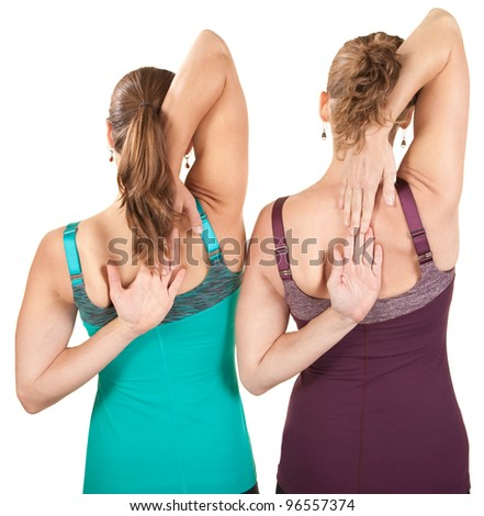 Two women stretching shoulders over white background