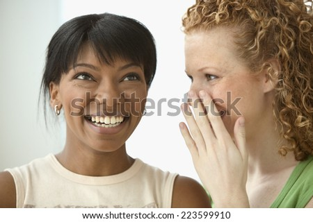 Two women talking - stock photo