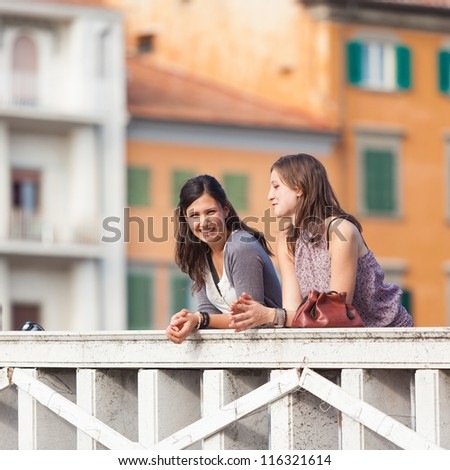Two Women Talking in the City - stock photo