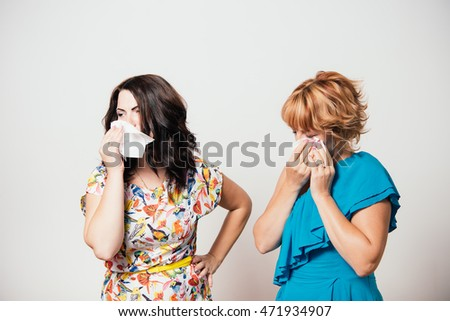 Two women weep