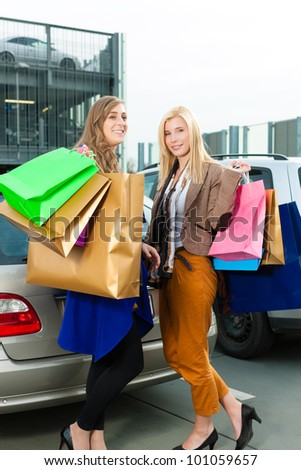 Two women were shopping in a mall or shopping centre and driving home now with their car