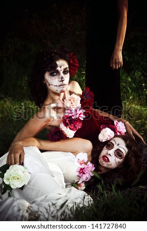 two women with scary masks - stock photo