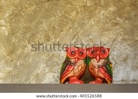 Two wooden carved Owl - stock photo