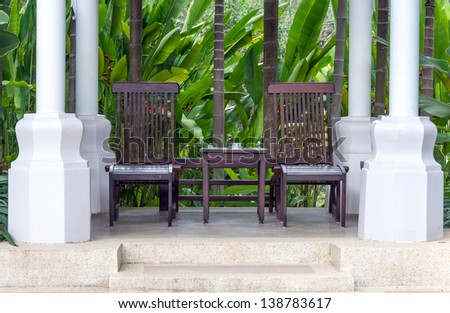 Two wooden chair in garden