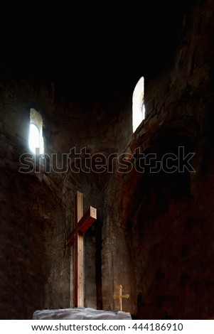 Two wooden crosses. Large and small in a very old church with two windows from which light pours. Concept of faith, hope and love. - stock photo