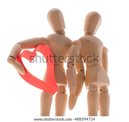 two wooden figure dummy mannequin, give romantic gift a big red heart, isolated on a white background - pictures concept theme Love and St. Valentine's Day. synonymous expression - I give you my heart