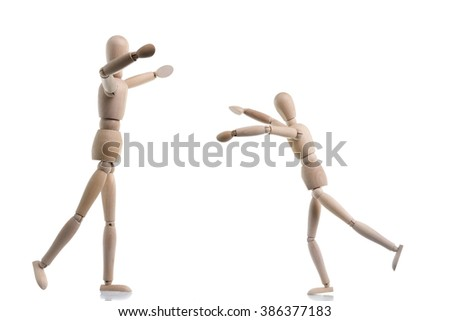 Two wooden figures are coming together to hug as a greeting, isolated on white.